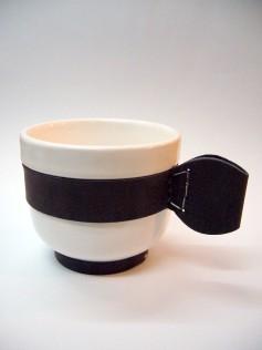 Tazon, cerámica y cuero